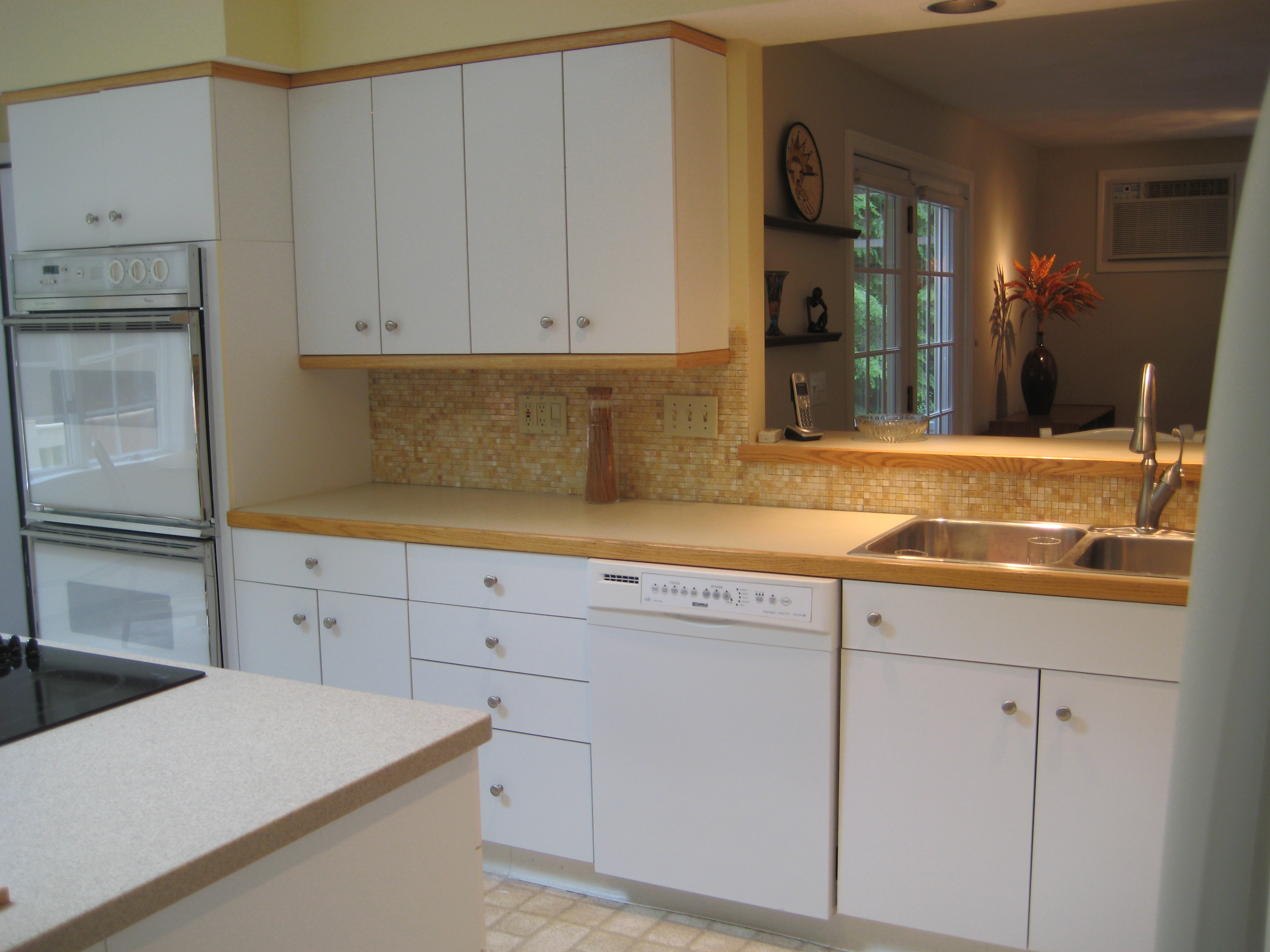 The benefits of having a white kitchen design ideas for for White kitchen cabinets with oak trim